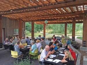 PCEI supporters enjoy a meal at The Nancy Taylor Pavilion in July 2015 and talk about the future work of PCEI.