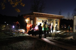 """The Welcome Pavilion's Center Stage, complete with windows and sliding doors, makes for a cozy ticket booth for October 2013's """"Animals of the Night"""" event."""