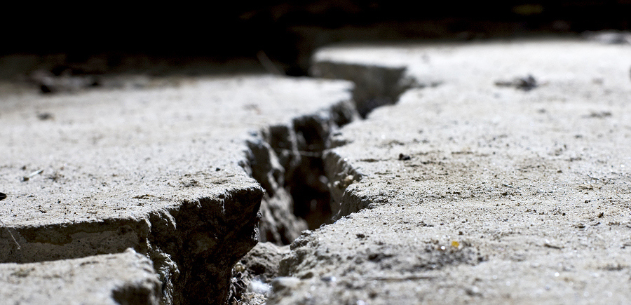 bigstock-cracked-road-concrete-close-up-26087300